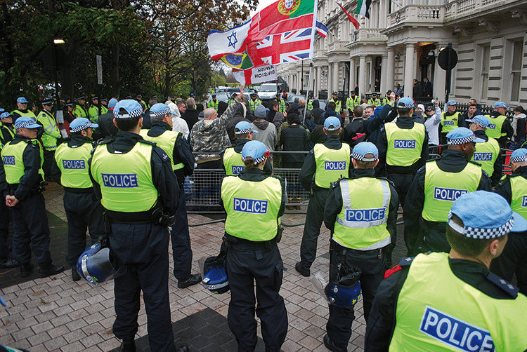 Police stand watch as EDL and MAC supporters gather on remembrance day, 11th November 2010
