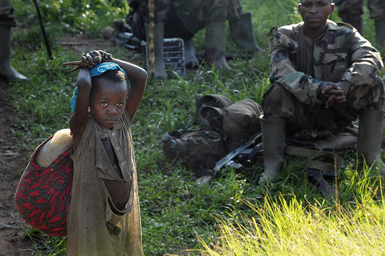 Villagers from Brazza approach Langira as they flee FDLR atrocities