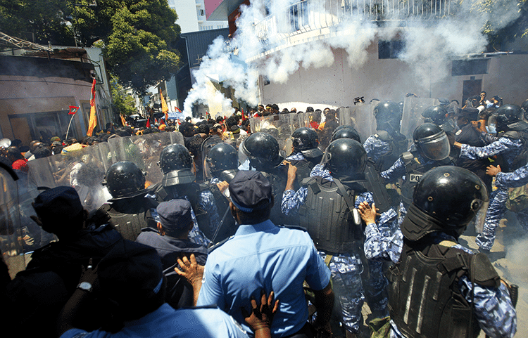 Nasheed's supporters are confronted by riot police, 19th March 2012. Photo: Sinan Hussain/AP/Press Association Images