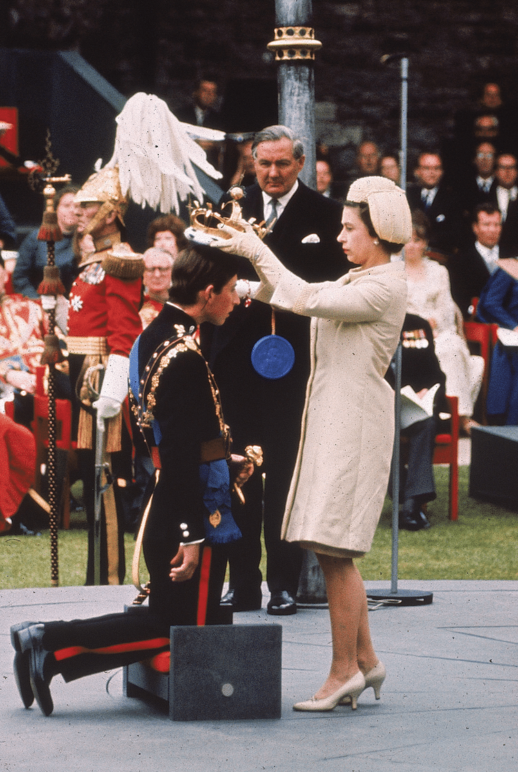 Queen Elizbeth II crowns her son, Prince Charles, as Prince of Wales during the investiture ceremony at  Caernarfon castle, 1st July 1969. Photo: PA/PA Archive/Press Association Images