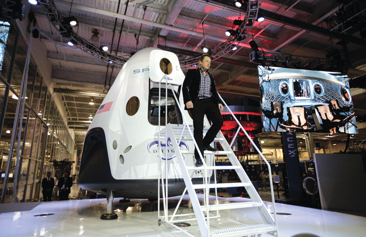 Elon Musk and his commercial Dragon V2 capsule. Photo: Jae C. Hong/AP/Press Association Images