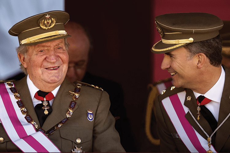 Juan Carlos with his son Felipe, shortly after the announcement of his abdication. Photo: Daniel Ochoa de Olza/AP/Press Association Images
