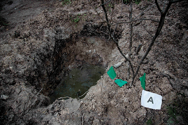 A clandestine grave in Iguala uncovered as officials worked to determine whether 28 bodies found at the site were those of the students abducted in September 2014. Photo: Marco Ugarte/AP/ Press Association Images