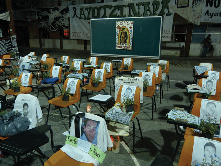 Students' images adorn school seats. Many parents believe their children are still alive, working on narcotics plantations. Photo: Témoris Grecko