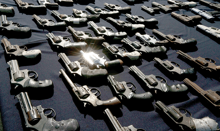 Pistols are displayed by police before their destruction in Panama City, on 6th August 2014. Photo: Arnulfo Franco/AP/Press Association Images