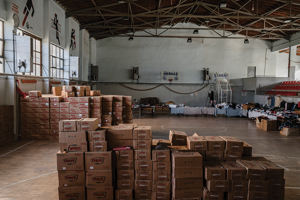 Donations of food, clothing and other household goods are stored at Soma's municipal sports complex, ready for distribution to miners' families. Photo: Guy Martin