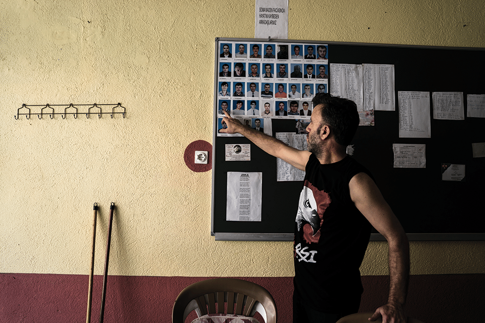 Former mine worker Musa Çakmak points to the 34 miners from the town of Savastepe who were killed at Soma. Photo: Guy Martin