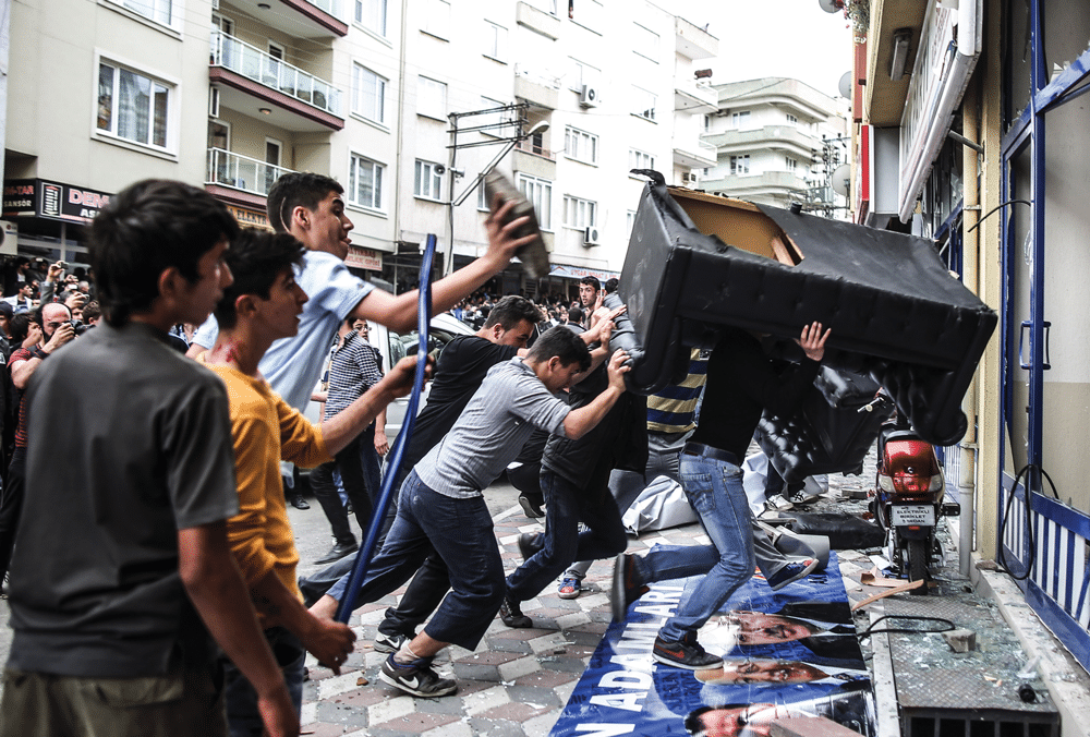 Protesters attack the Soma offices of Turkey's prime minister Recep Tayyip Erdogan as he visits the mine surrounded by security members on Wednesday 14th May 2014. Photo: Emrah Gurel/AP/Press Association Images