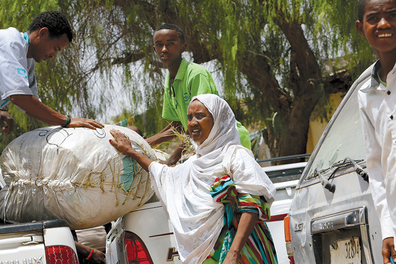 Khat mogul Shura Adnan handles a newly arrived shipment of her product