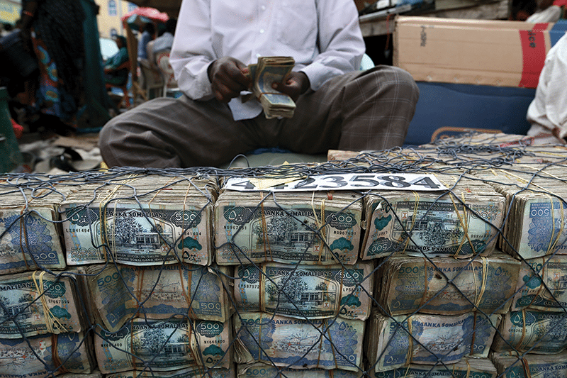 Cash from khat sales is brought to money changers and exchanged for Ethiopian birr to buy the next day's supply