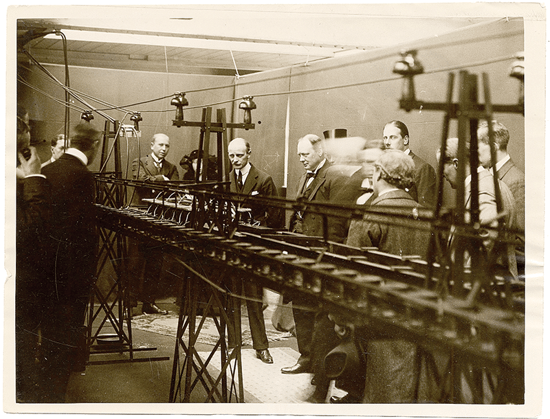 1914: Emile Bachelet demonstrates the first working model of a magnetic train to Winston Churchill in London