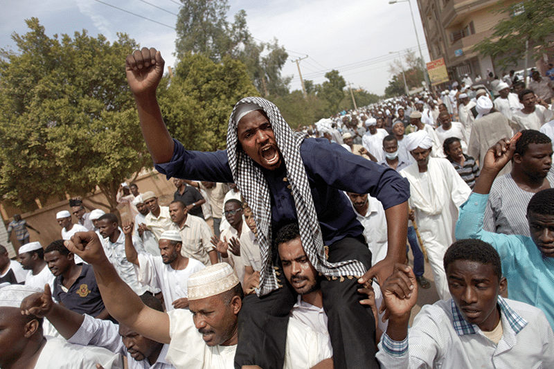 Dissatisfaction with Sudan's struggling economy sparked a series of deadly protests across Khartoum in autumn 2013 Photo: Khalil Hamra/AP/Press Association Images