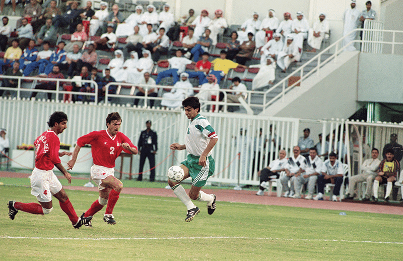 Iran's Javad Zarinchech (centre) and Iraqi captain Ahmad Radhi (right) during their World Cup qualifying game, 22nd October 1993. Photo: Santiago Lyon/AP/Press Association Images