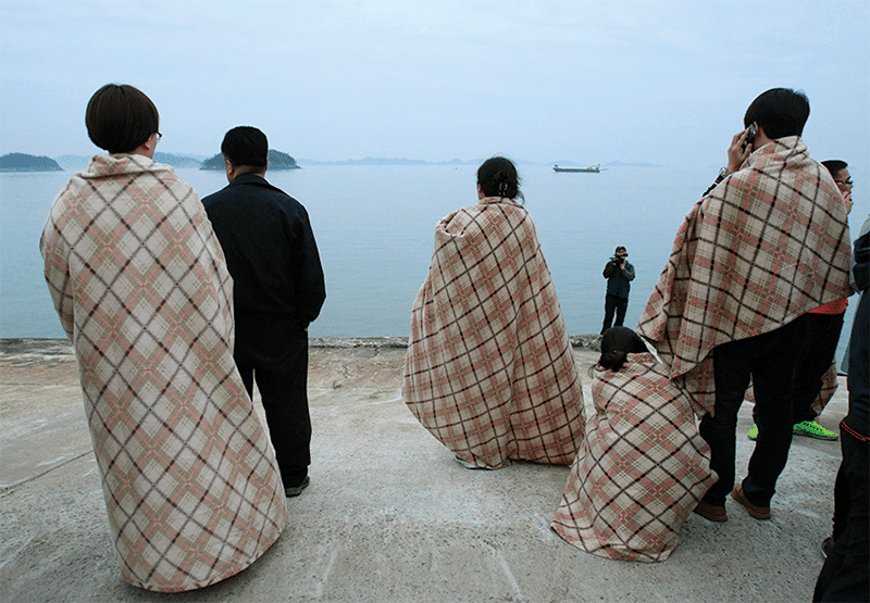 Relatives wait for their missing loved ones at a port in Jindo, South Korea, Wednesday, April 16, 2014. Photo: Ahn Young-joon/AP/Press Association Images