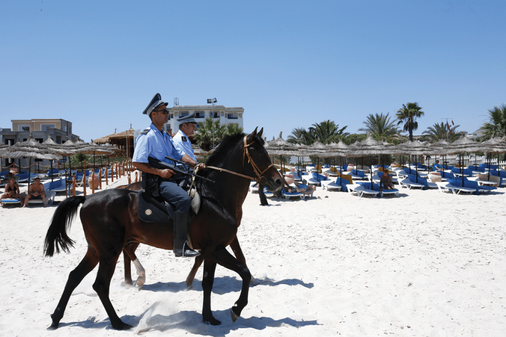 Mounted police officers patrol the beach of Sousse, Tunisia on Sunday June 28, 2015. Photo: Abdeljalil Bounhar/AP/Press Association Images
