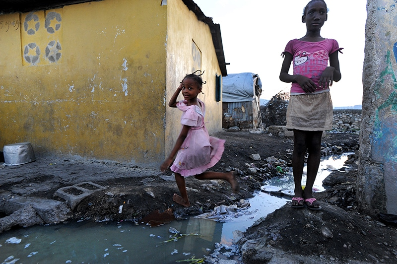 Lack of water and sanitation in Port-au-Prince condemns the population to potential infection as filthy canals criss-cross the area and overflow into homes when it rains