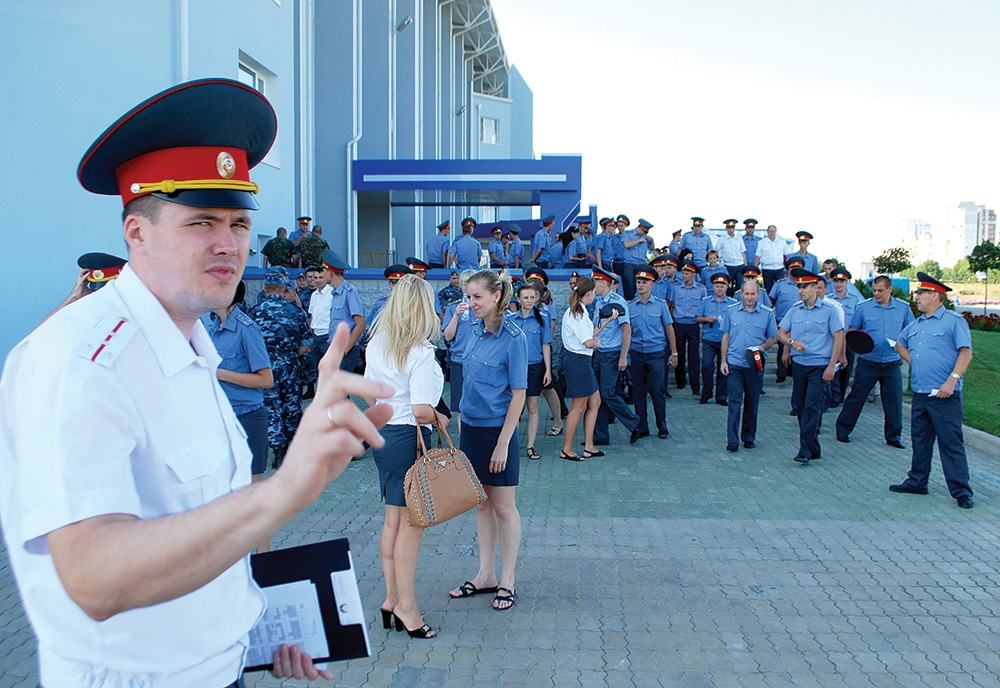 A Transnistrian police officer is sceptical about photography