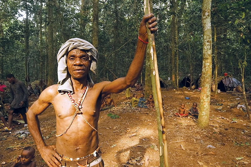 A Ba'aka hunter poses with his wooden spear