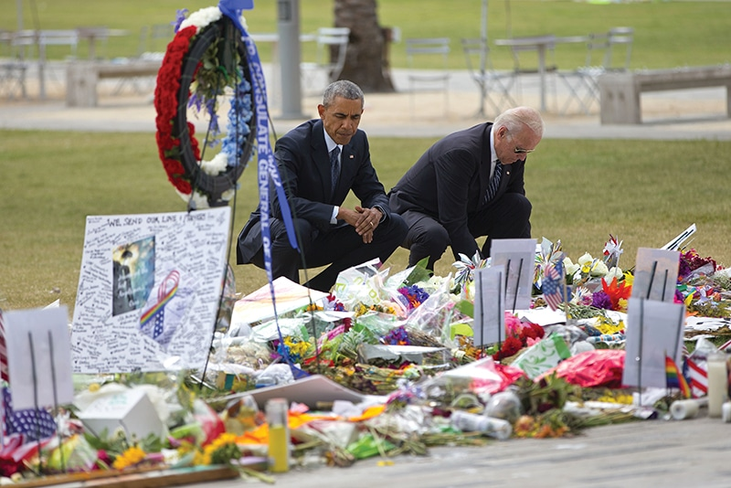 US president Barack Obama and vice president Joe Biden visit a memorial to the victims of the Pulse shooting on 16th June. Photo: Pablo Martinez Monsivais/AP/Press Association Images