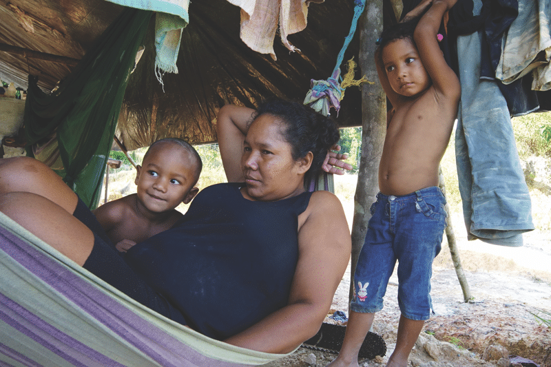 Evadney Abrahms, who works as a cook for one of the miners, with her children. Photo: Susan Schulman