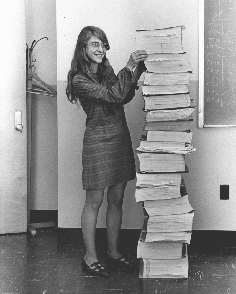 Margaret Hamilton standing next to the navigation software she and her MIT team produced for Project Apollo.  Photo: Draper Laboratory