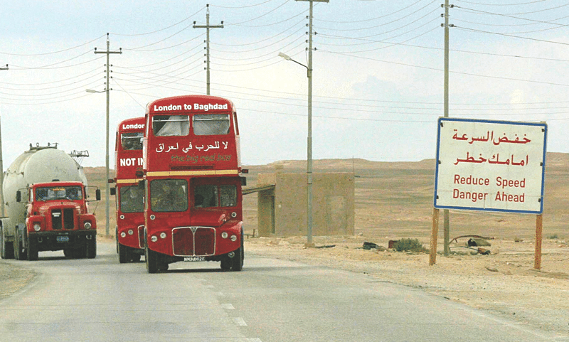 Twenty-five kilometres to Baghdad, 15th February 2003.  Photo: Julian Simmonds