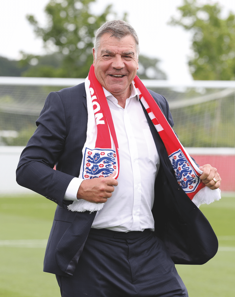 Poses with an England scarf on 25th July 2016, the day he was unveiled as England manager.  Photo: artin Rickett / PA Wire / PA Images