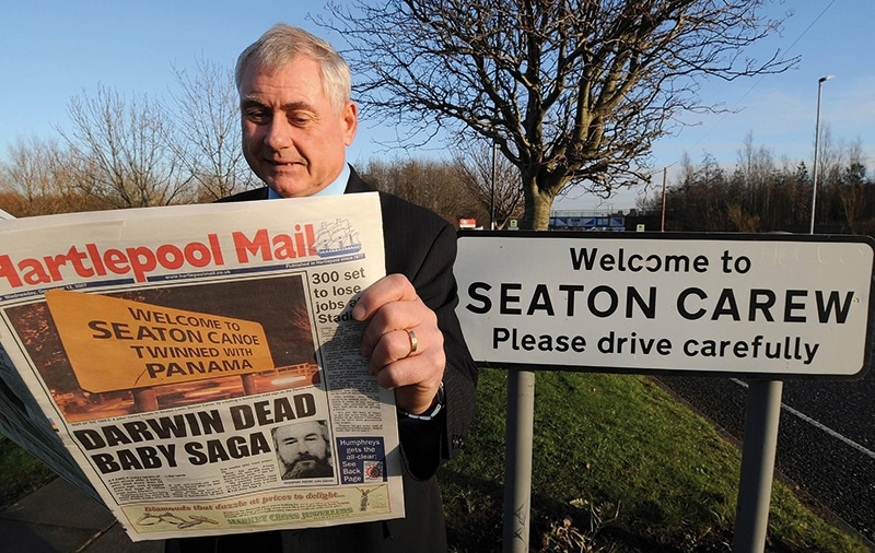 A Seaton Carew businessman catches up with local news, December 2007.  Photo: John Giles/PA Wire
