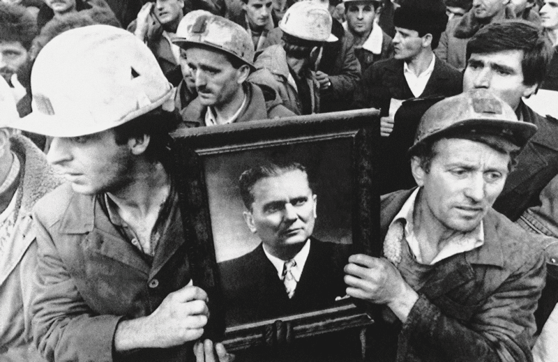 Miners carry a portrait of the late Marshal Tito in demonstrations in Priština, November 1988.  Photo: AP / PA Images