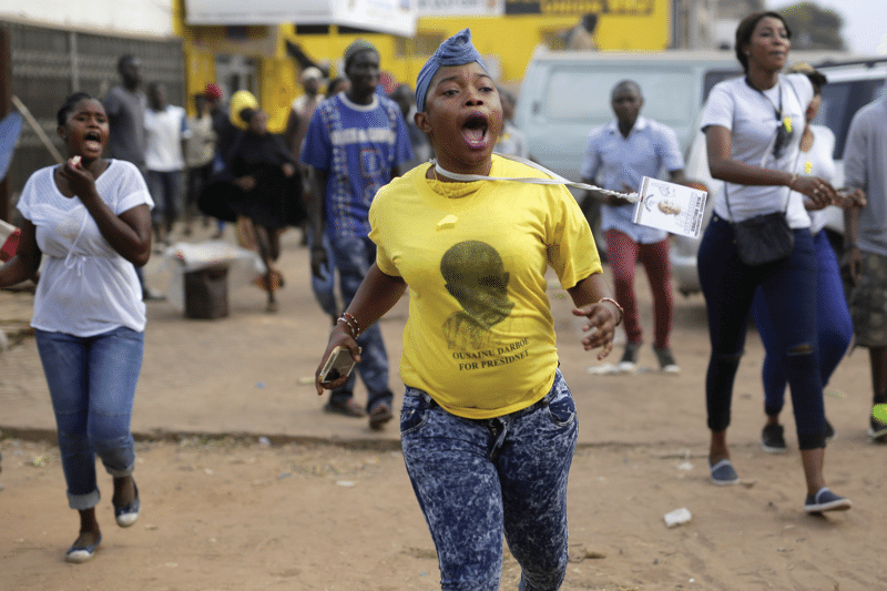 A UDP supporter wears a campaign T-shirt for the former leader Ousainou Darboe, who was imprisoned in July 2016.  Photo: Jerome Delay / AP / PA Images