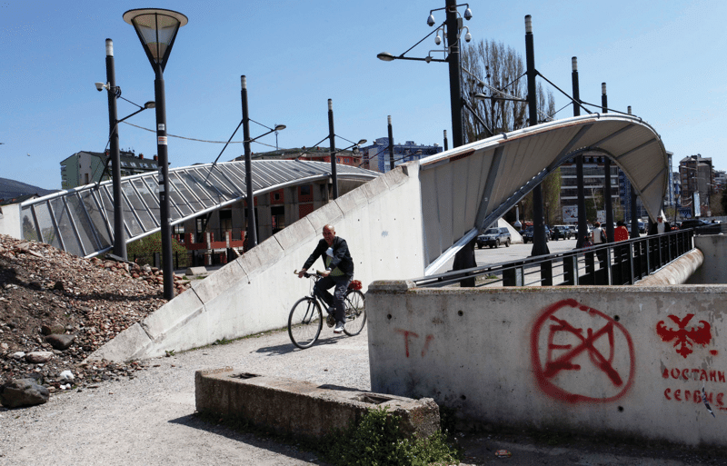 The bridge between ethnic-Albanian-dominated southern Mitrovica and the Serb-majority northern part of the city, April 2013.   Photo: Zveki / AP / PA Images