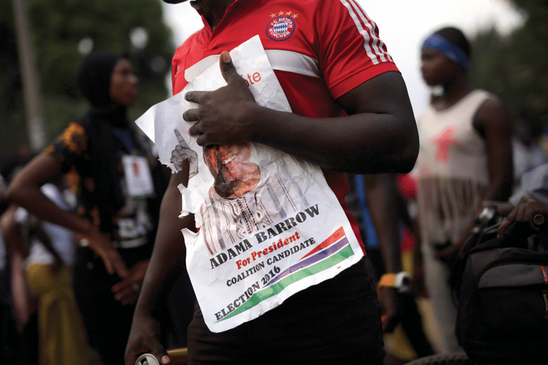 An opposition supporter in the Talinding district of Banjul, three days before the election.  Photo: Jerome Delay / AP / PA Images